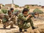 Người Kurd Syria giao tranh ác liệt với IS, đoạt 5 quận tại Raqqa