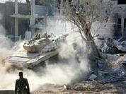 Hàng nghìn phiến quân Syria đầu hàng, di tản khỏi quận Al-Qaboun, Damascus (video)