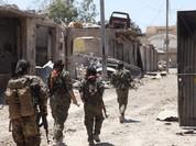 Chiến sự Syria: Người Kurd chiếm thành cổ Raqqa, IS sắp bị chia cắt (video)