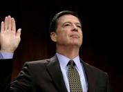 Giám đốc FBI J. Comey biết tin mình bị sa thải qua TV