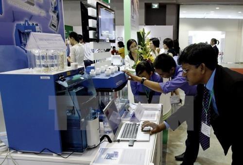 Công nghệ số kết hợp với kinh tế truyền thống - Xu hướng mới trên toàn cầu. Ảnh minh họa: TTXVN