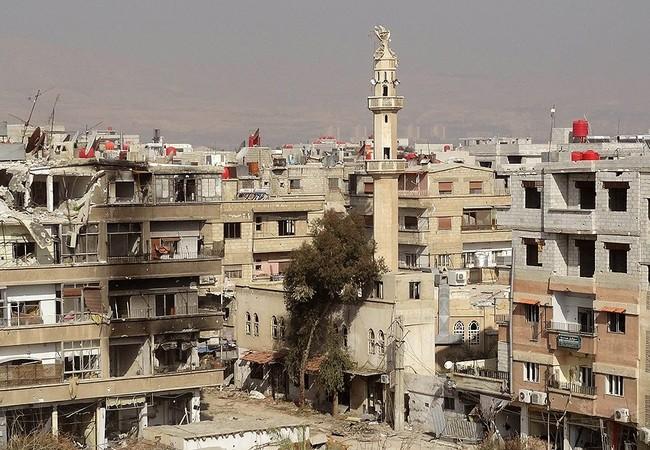 Chiến sự Syria diễn ra ác liệt trên đống hoang tàn