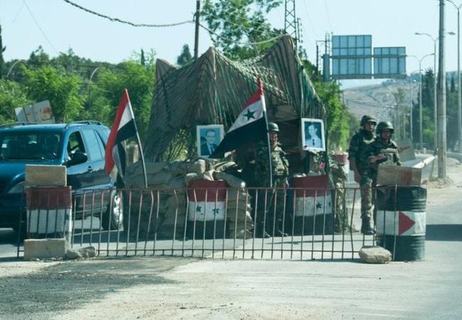 Một trạm kiểm soát của quân đội Syria ở Aleppo