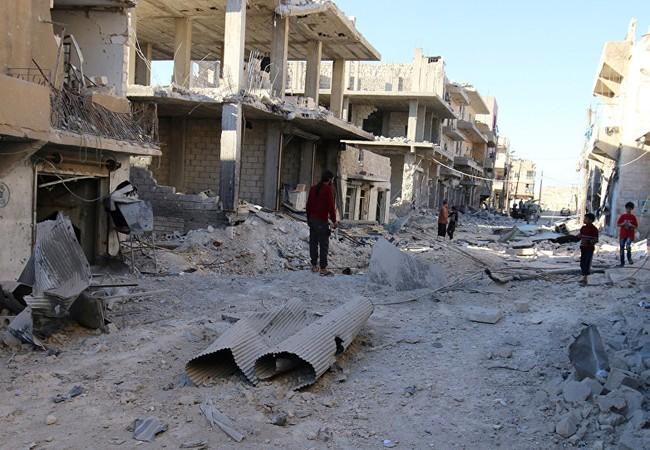 """Một khu phố ở Aleppo, tan hoang sau những trận pháo kích bằng """"pháo địa ngục"""" của lực lượng Hồi giáo cực đoan"""