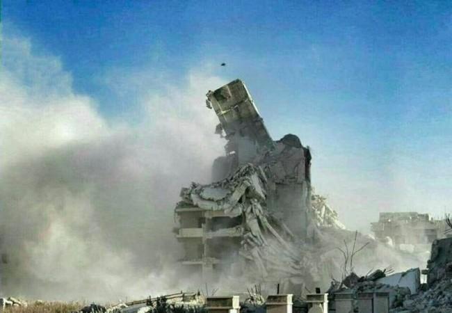 Khung cảnh tàn phá tan hoang ở quận Al-Wa'er thuộc thành phố Homs