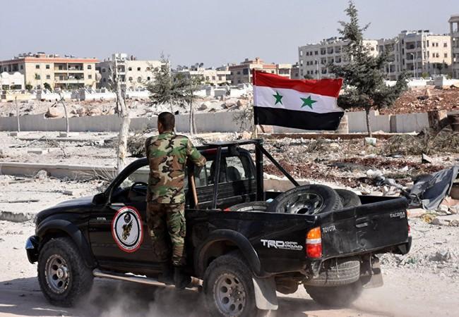 Binh sĩ Syria trên một đường phố giải phóng