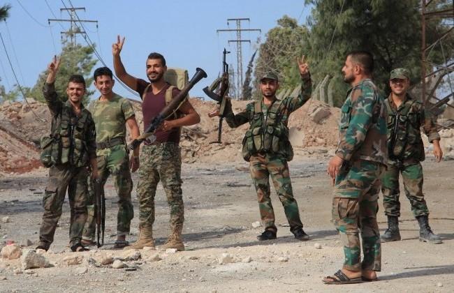 Binh sĩ quân đội Syria trên những ngôi làng vừa giải phóng