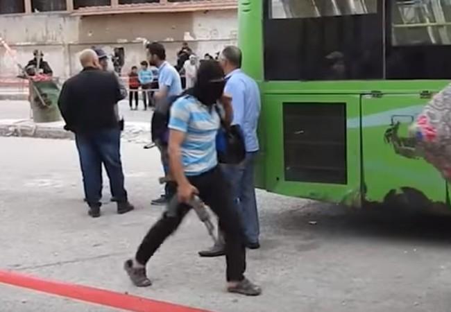 Lực lượng chiến binh di tản khỏi thành phố Homs